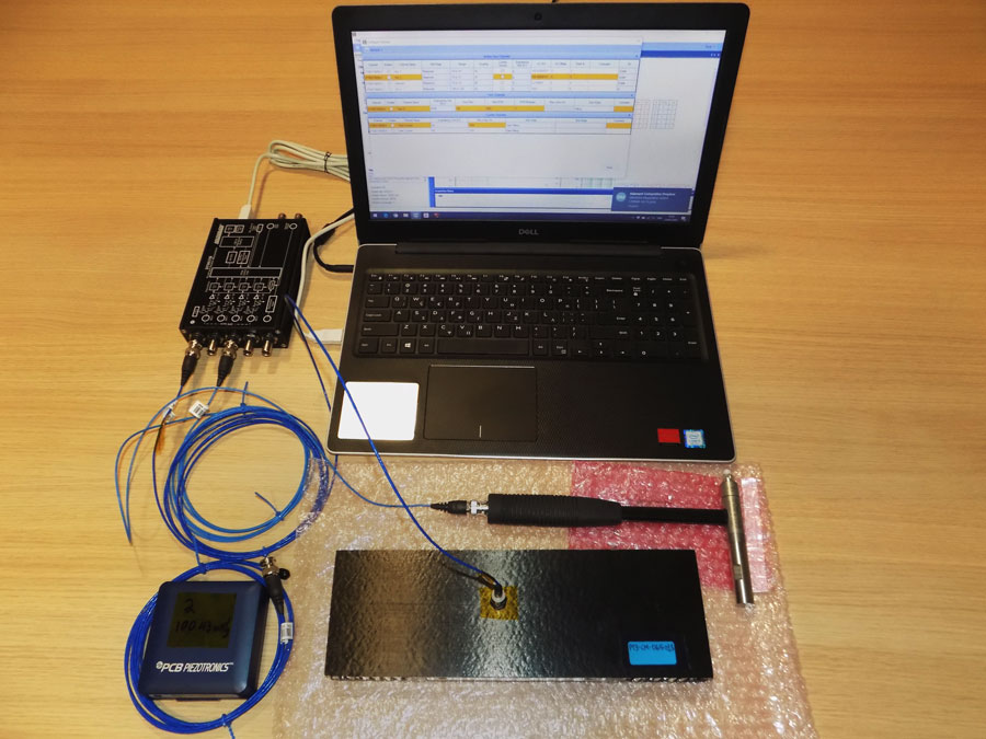 Laptop connected with testing accessories